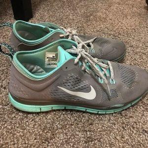 Sea foam green & grey Nike tennis shoes